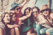 canvas print picture - group of crazy nice beautiful caucasian girls outdoor under the summer sun doing a party all together. people having fun iall together oncept lifestyle. shout and laugh full of joyful women