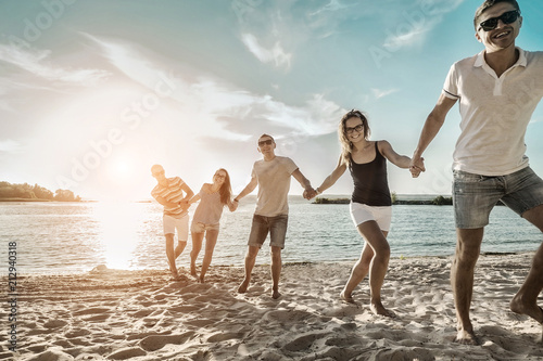 Happiness Friends fun on the beach under sunset sunlight in summer