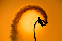 IN Pattaya , Thailand - December 6, 2015 : Thai Man Hovered Above The Water. Fly Boarding Silhouette.Silhouette Of A Fly Board Rider At Sea.