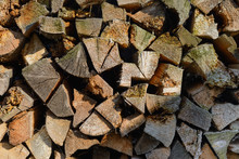 Folded Chopped Firewood Lit By The Sun