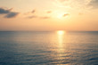 Sunset Sea over the Horizont. Beautiful Ocean Sunshine Landscape, Shimmering Twilight with yellow colors, Warm marine dusk Sun, Reflecting sunlight over the water