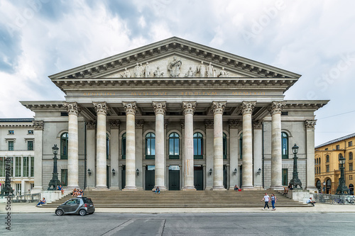 Papiers peints Opera, Theatre Munich, Germany June 09, 2018: National Theater neoclasical styled building at Max Joseph square in old town in a sunny day. This landmark acts as the Bayerische Staatsoper headquarters