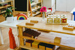 Shelving in a Montessori class with lock boxes