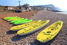 Row Of Colorful Kayaks On A Pe...