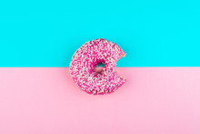 One Pink Isolated Donut On A M...