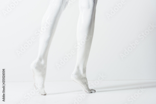 Cropped Image Of With Legs Painted White Paint Walking On Floor