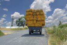 Fully Loaded, Tractor With Trailer Transports Straw Bales.