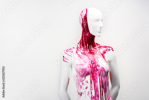 white female mannequin in red paint isolated on white
