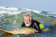 Mature Surfer Ready To Catch A...