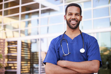 Young black male healthcare worker smiling outside, portrait
