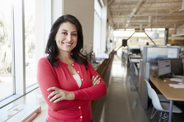 Female Hispanic architect smiling to camera in an office