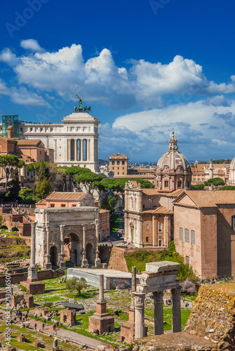 Ancient ruins, classical monuments and baroque church in the historic center of Rome (with copy space above)