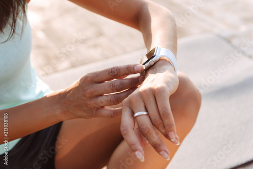 Foto op Canvas Pedicure Young sports woman outdoors on the beach