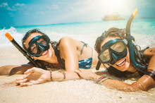 Two Happy Girlfriends With Snorkeling Mask Enjoying On The Beach