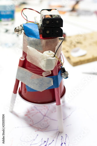 Plastic cup with DC motor and batteries writing with a