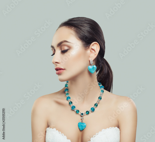 Cute Young Woman with Makeup, Silver Necklace and Earrings with Diamond and Blue Fototapeta