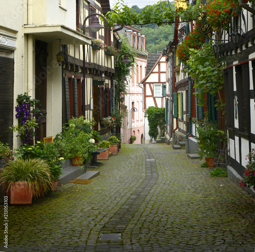 Fotobehang Zuid-Amerika land old small German town on the river bank narrow streets, pavement flowers on the windows