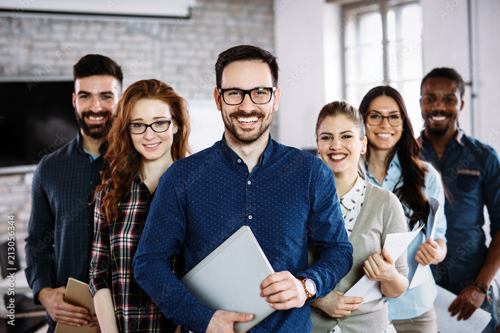 Fototapeta Portrait of successful business team posing in office
