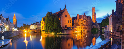 Foto op Canvas Brugge Scenic cityscape with tower Belfort and Church of Our Lady from the quay Rosary, Rozenhoedkaai, at night in Bruges, Belgium