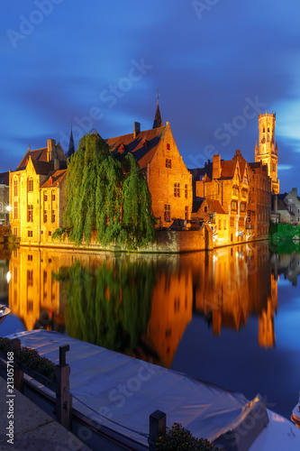 Wall Murals Bridges Scenic cityscape with a medieval fairytale town and tower Belfort from the quay Rosary, Rozenhoedkaai, at night in Bruges, Belgium