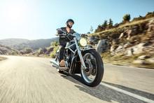 Young Man Riding A Motorbike