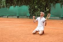 Blond Winner With Racket Celeb...