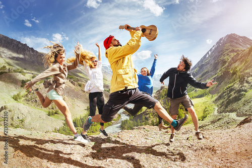 Group of happy friends music jumps trekking fun