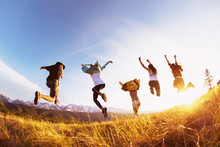 Group Happy Friends Runs And Jumps Mountains Sunset