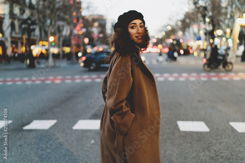 Fotografia, Obraz Elegant business woman with curly hair enjoying walking the city after hard working day