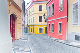 Fototapeta Uliczki - Empty narrow cobblestone street in downtown in Prague, Czech Republic