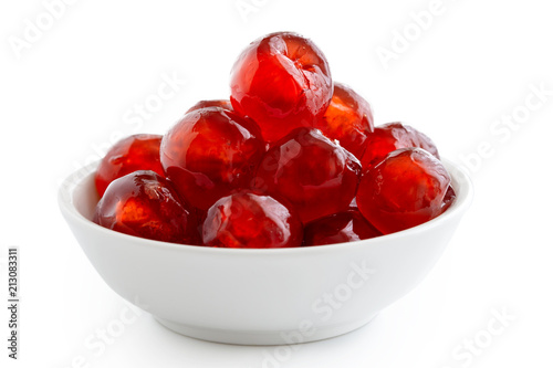 Red glace cherries in white bowl isolated on white. Fototapete