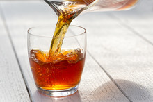 Pouring Ice Tea From A Glass J...