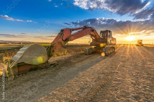 Fototapeta Modern excavator machine in remote area on site