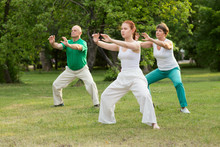 Group Of People Practice Tai C...