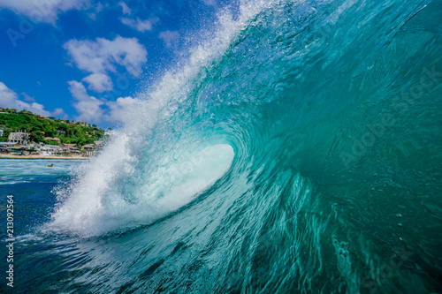 Fotobehang Zee / Oceaan A wave breaks on a reef in a tropical paradise beach in Bali