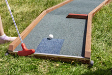 Closeup Of Player Play Mini Golf