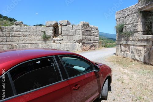 Vászonkép Red car in Arcadian gate, ancient Messini, Peloponnese, Greece