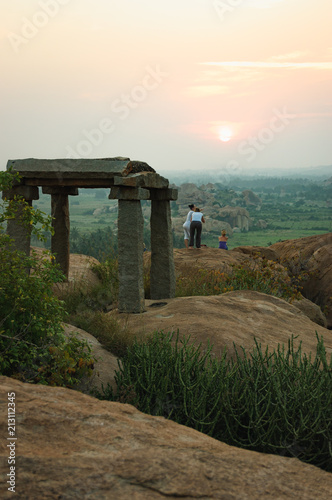 Picturesque view from the Malyavanta Hill at sunset overcast sky in Hampi, Karnataka, India Poster