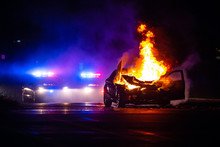 Car On Fire At Night With Poli...
