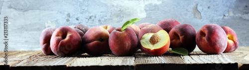 Obraz na plátně A group of ripe peaches on table