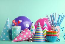 Birthday Party Caps, Balloons And Cups With Paper Straws On Mint Background
