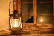 Vintage Kerosene Lamp At Window