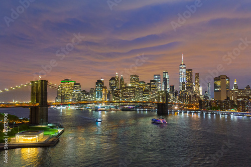 In de dag New York City Brooklyn, Brooklyn park, Brooklyn Bridge, Janes Carousel and Lower Manhattan skyline at night seen from Manhattan bridge, New York city, USA. Black and white wide angle panoramic image.