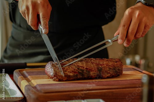 Fotografia, Obraz  table side service at fine dining restaurant