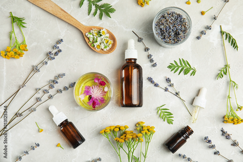 Fototapety, obrazy: Flat lay composition with essential oils and flowers on light background