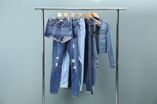 Rack With Stylish Jeans And De...
