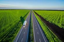 White Trucks Driving On Asphal...