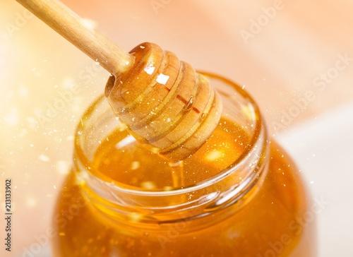 Papiers peints Singapoure Honey and wooden spoon