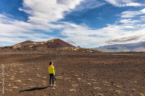 Papiers peints Cappuccino Hiking in Iceland - Adventure travel. Videographer girl tourist on wanderlust walk filming video with camera. Hero landscape shot of desert nature.