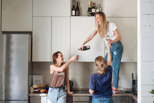 three women with bottles of alcohol Poster
